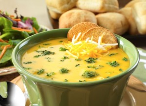 A bowl of cheese and broccoli soup